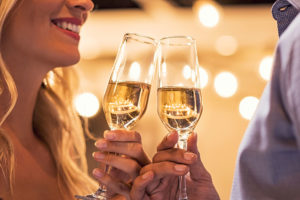 Man and woman toasting champagne flutes
